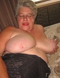 Sexy Mature Cougar streached out on the bed happy to show off all my hairy wettness for you to enjoy